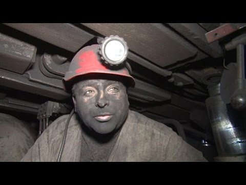 Ukrainian coal miners work to stave off electricity...