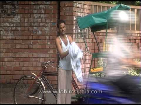 Rikshawala gets drenched in rain