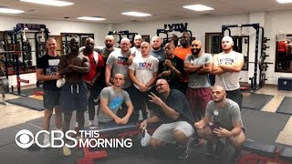 Football players shave their heads to honor coach diagnosed with cancer