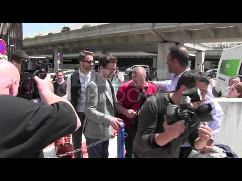 Camera shy Ryan Reynolds arriving at Cannes airport