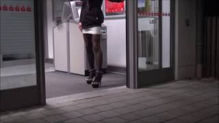 crossdresser in mega plateau heels and micro skirt