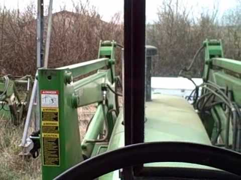 How to take the John Deere 265 loader off the 4230