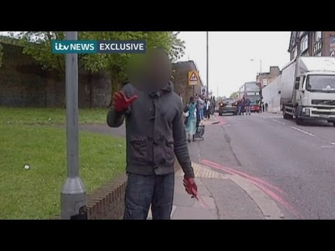 Woolwich attack: Man with blood on hands holds knife at Woolwich attack scene (ITV News)