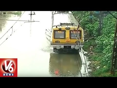 Heavy Rain Hits Mumbai, Roads And Train Ways Blocked As City Records Highest Rainfall | V6 News
