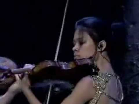Vanessa lying next to gismo, her violin