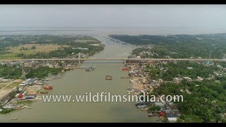 Bird's eye view of Namkhana bridge over Hatania-Doyania River in West Bengal - 4K Aerial