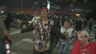 WHO DAT: Saints fans celebrate clinching NFC top seed in New Orleans