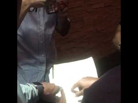 Sabir Bey and Eddie Griffin showing him his name in Amharic