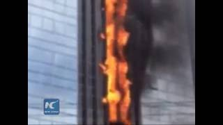High-rise building on fire, flame in the shape of