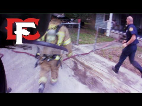 Firefighters Rescue Victim from Burning Home