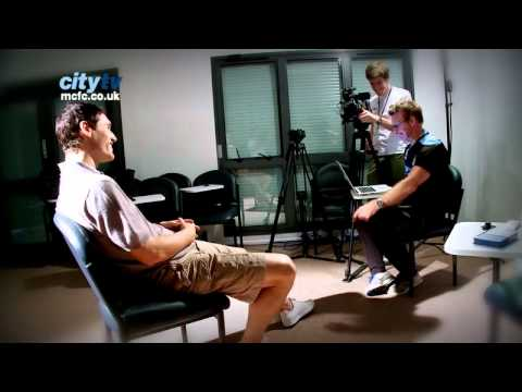 Gareth Barry gets quizzed by Man City's kit man Les Chapman