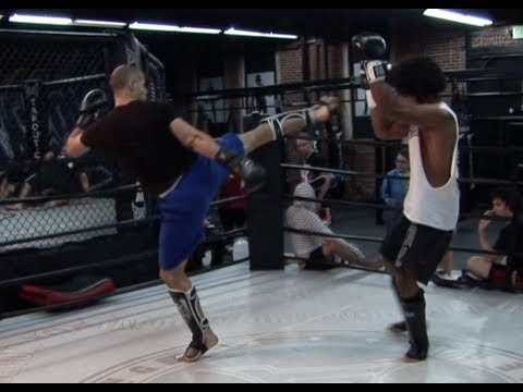 Fit at age 49 having a Light Kickboxing sparring with my coach, a pro MMA FIGHTER Image 1