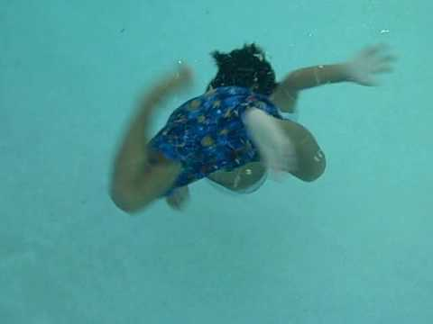 4 year old swimming in the deep end (8.5 ft) to retrieve dive stick - Life In A Day (Ridley Scott)