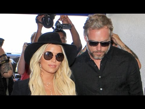 Jessica Simpson And Eric Johnson Mobbed At LAX Headed For NYC