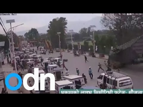 Nepal earthquake: CCTV shows archway collapsing onto busy road of people