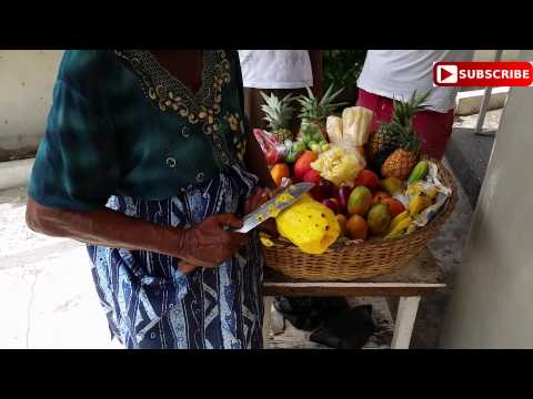 Jamaica Women Lady Shows Shows How to Clean a Pineapple FAST!!!