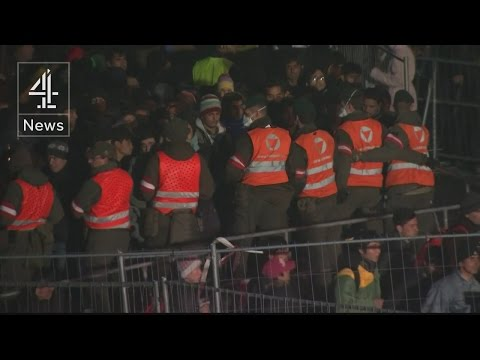 Refugee crisis: people rushing through Austria's border fence