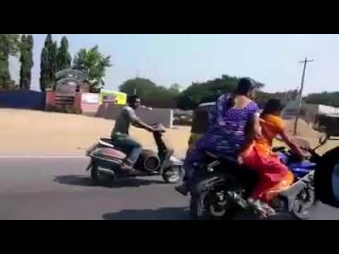 What the fuck is this. What's going on in India .. aunty driving heavy bike thumbnail