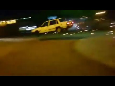 Volvo 740 jumps over roundabout