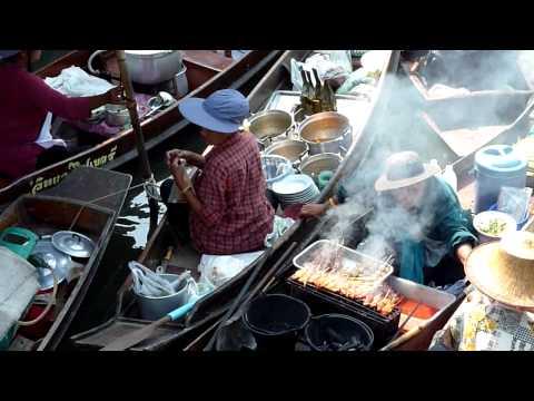 Preparing food at the Tha Kha floating market.