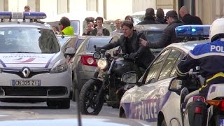 Tom Cruise dangerously rides his bike without an helmet on the movie set of MI6 in Paris.