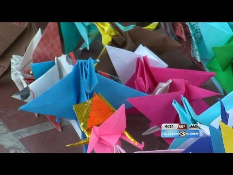 Group hangs thousands of paper cranes for peace