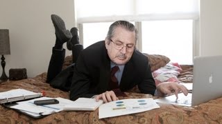 Businessman Does His Work Lying On Bed Like Schoolgirl