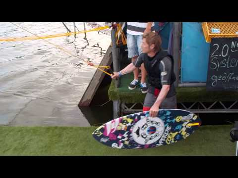 Andy running dock start with wake surf board at cable park Velten Berlin