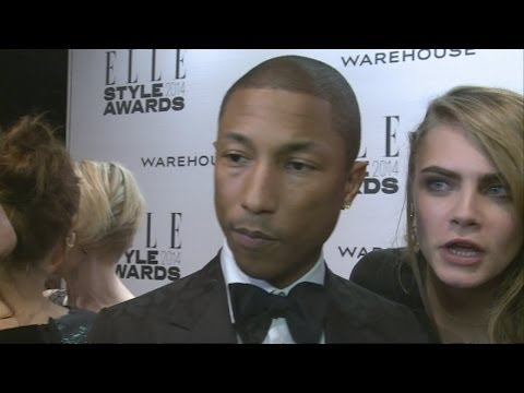 Cara Delevingne video bomb! Cara barges into Pharrell's interview at Elle Style Awards