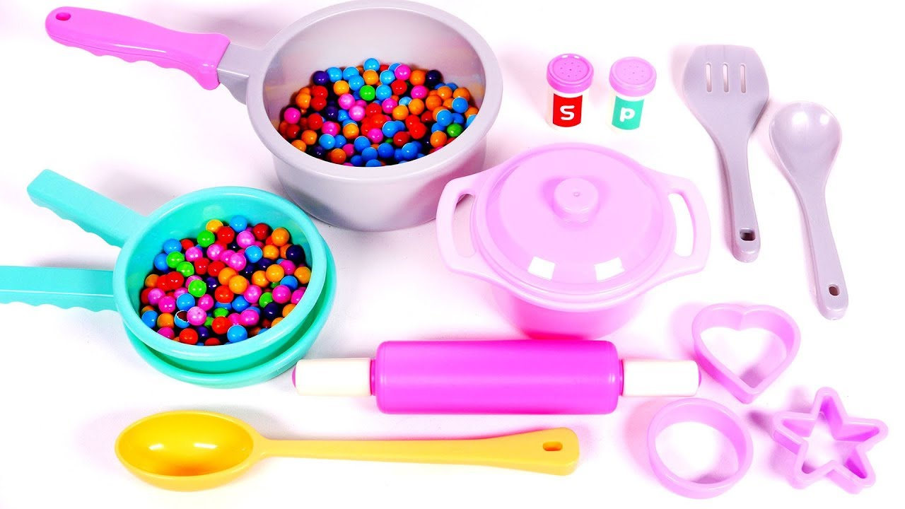 cooking with pots pans candy and play doh for children