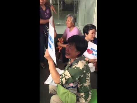 Distraught relatives protest outside Malaysia Airlines office in Beijing, China