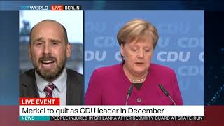 Merkel to resign as party chief but stays on as chancellor