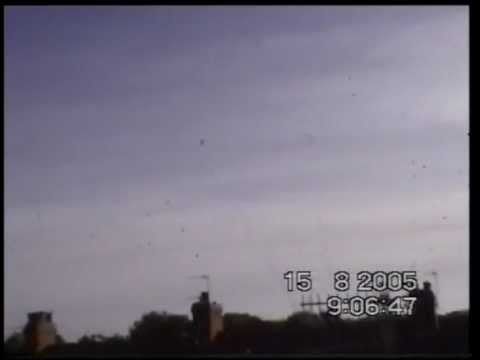 BLACK METALLIC LOOKING UFO ROLLING THROUGH THE SKY GUISBOROUGH UK  20-30 FEET IN SIZE