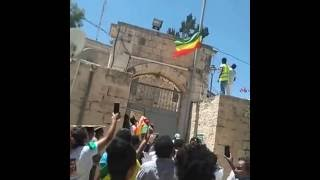 Ethiopian Protesters in Jerusalem removed flag used by the regime in Ethiopia from Holy Covenant chu