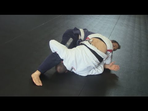 Rolling armbar from closed guard - BJJ closed guard submissions Image 1