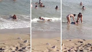 Old Women Stuck In Tiny Waves On Beach