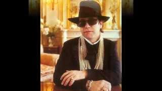 Watch Elton John Memory Of Love video