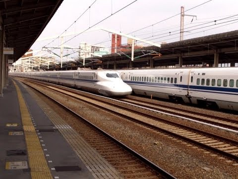 Limited Stop Shinkansen (japanese Bullet Train) Fly By, While The Local Shinkansen Waits! video