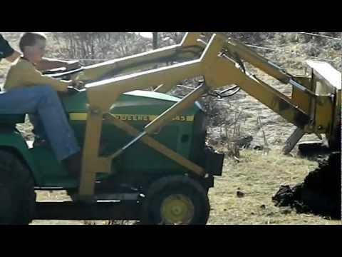 John Deere 445 loader work - future heavy equipment operator.MOV