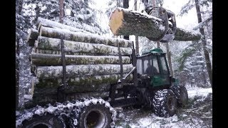 Logging in winter forest with Timberjack 1210