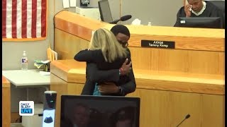 Botham Jean's Brother Hugs Amber Guyger