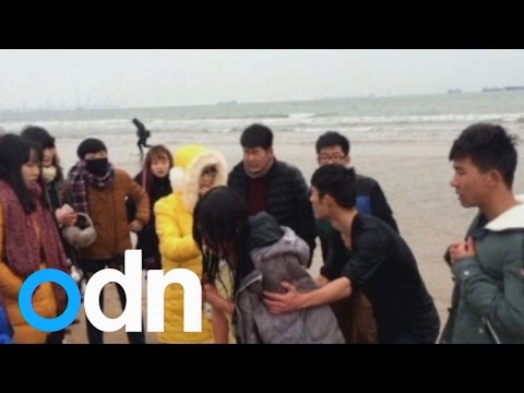 University Students Rescue 'suicidal' Woman From China Sea video