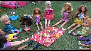 Elsa and Anna toddlers picnic with Barbie and her friends and swim in the lake