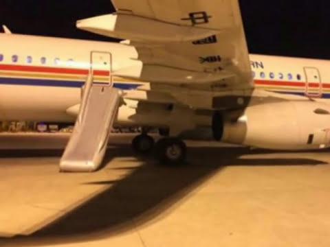 Passenger deploys emergency slide to get off plane early