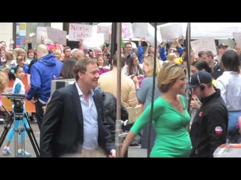 Savannah Guthrie and husband Michael Feldman holding hands at Today Show