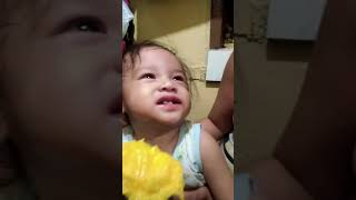 Funny baby..  Eating mango reaction...