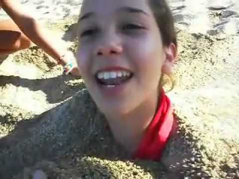 GIRL BURIED IN SAND