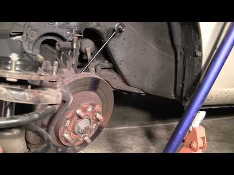 How-To Replace Front Struts on Most Cars : 2001 Mazda Protege Example