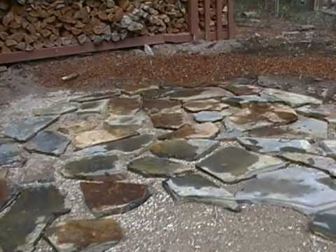 How to lay a flagstones patio part 1of2 mp4 youtube for How to build a river rock patio