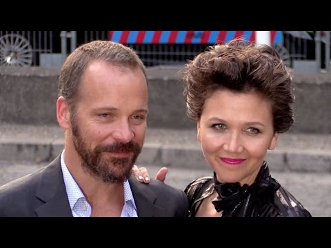 Maggie Gyllenhaal  and husband Peter Sarsgaard attending Miu Miu party in Paris